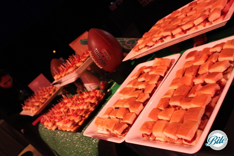 Football, astro turf and assorted slider bar for stationary display