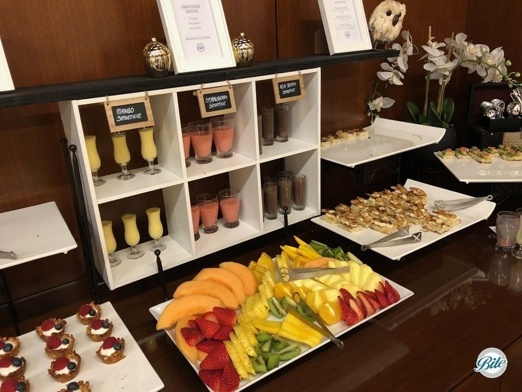 Breakfast Smoothies in Display for workshop. Surrounded with fresh fruit, granola canape, and tartines