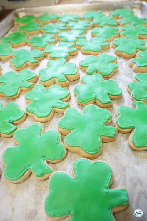 Shamrock-shaped cookies with green icing