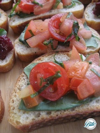 Bruschetta crostini with basil, olive oil and heirloom tomatoes