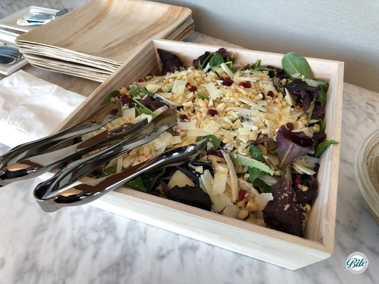 Spanish harvest salad. Endive, mixed greens, shaved fennel, crushed marcona almonds, apple, pomegranate, shaved manchego with sherry vinaigrette. Served on a deluxe wooden tray as part of seasonal lunch menu.