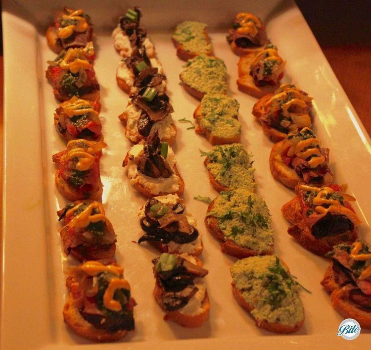 Crostini Bar Flank steak with Asian chimmichurri and sriracha aioli Edamame hummus with cilantro Shitake mushroom ragu