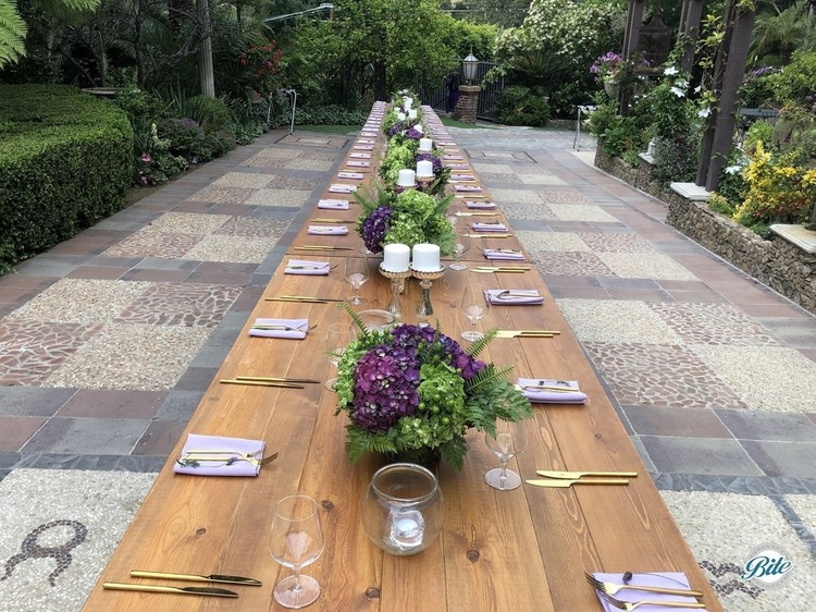 A long table laid out for a beautiful evening at the Houdini Estate
