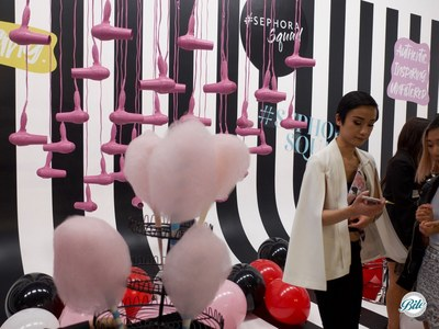 Cotton candy on a display with hairdryers and balloons in the backdrop