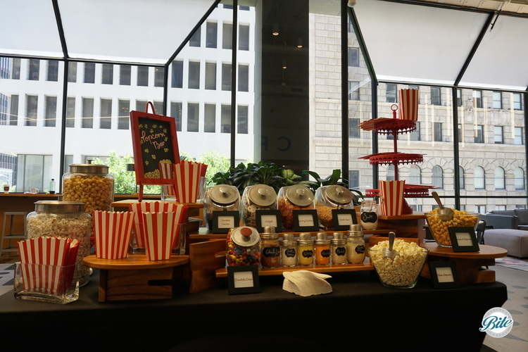 Popcorn Bar setup in a corporate office. Plain and flavored popcorn with shakers to add fun flavors. Candy jars add color.