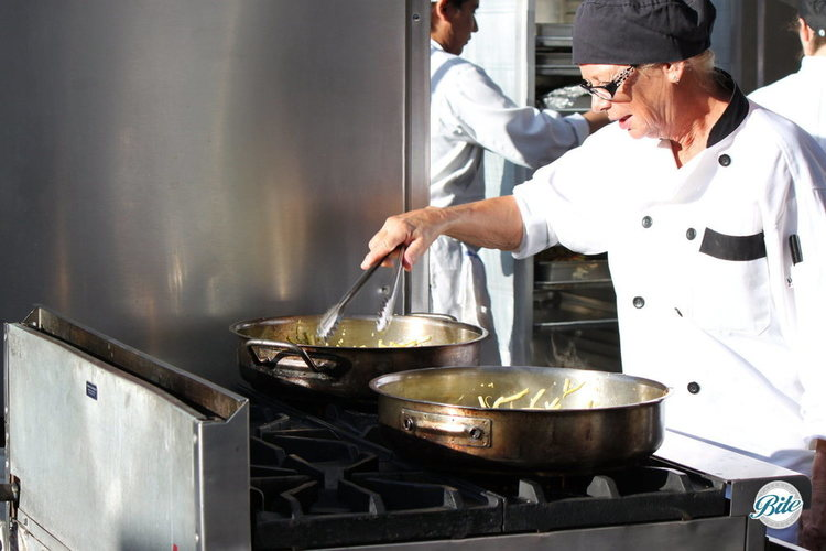Chef cooking in an outdoor kitchen