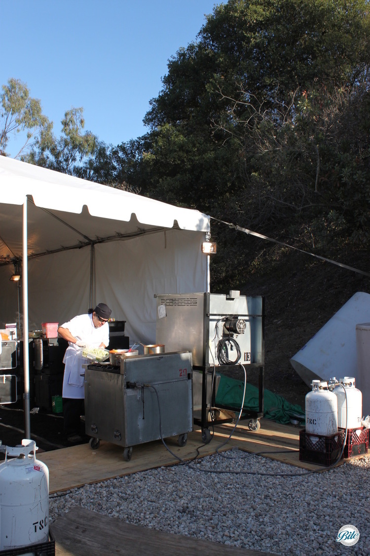 Setting up a field kitchen under a large tent