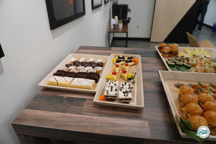 Dessert Assortment including lemon bars, brownies, dessert shots, and more