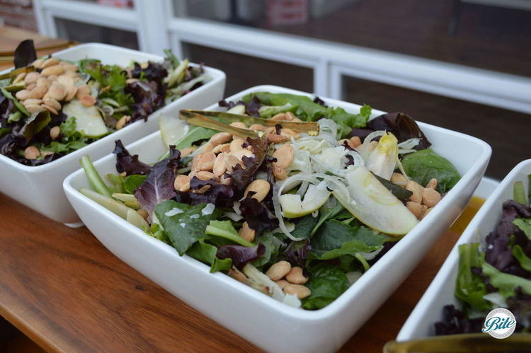 Spanish harvest salad with endive, mixed greens, shaved fennel, almonds, apples, pomegranate, cheese, vin
