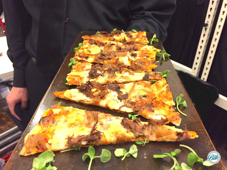 Short Rib Flatbread with caramelized onions, smoked gouda. Sliced and tray passed