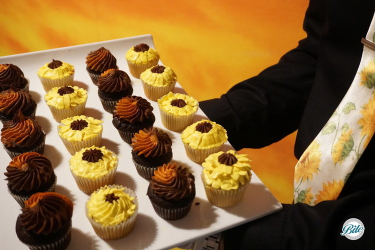 Sunflower themed cupcakes - yellow and brown/ orange.  Coordinated with servers wearing sunflower ties