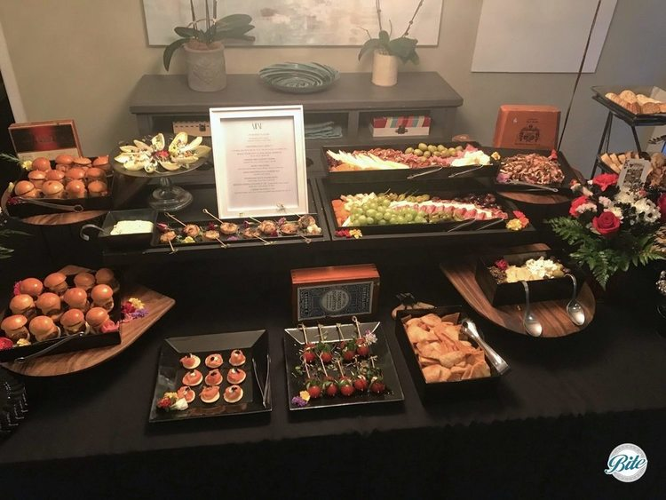 Assortment of bites. Sliders, shrimp, canapes, caprese skewers, antipasto, meze, crostini, blini, endive, and more