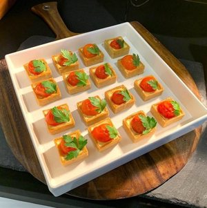 Tomato and Herb Tarts in White Bowl