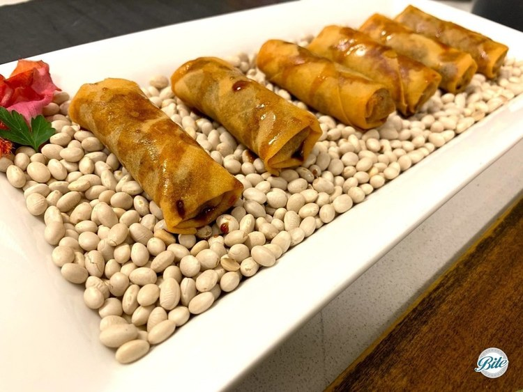 Vegetable eggrolls. Asian vegetables tossed with soy sauce, sesame oil, and ginger.  Drizzled with a ginger soy reduction