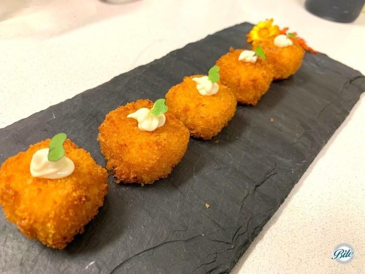 Mac n cheese bites. served with a truffle aioli
