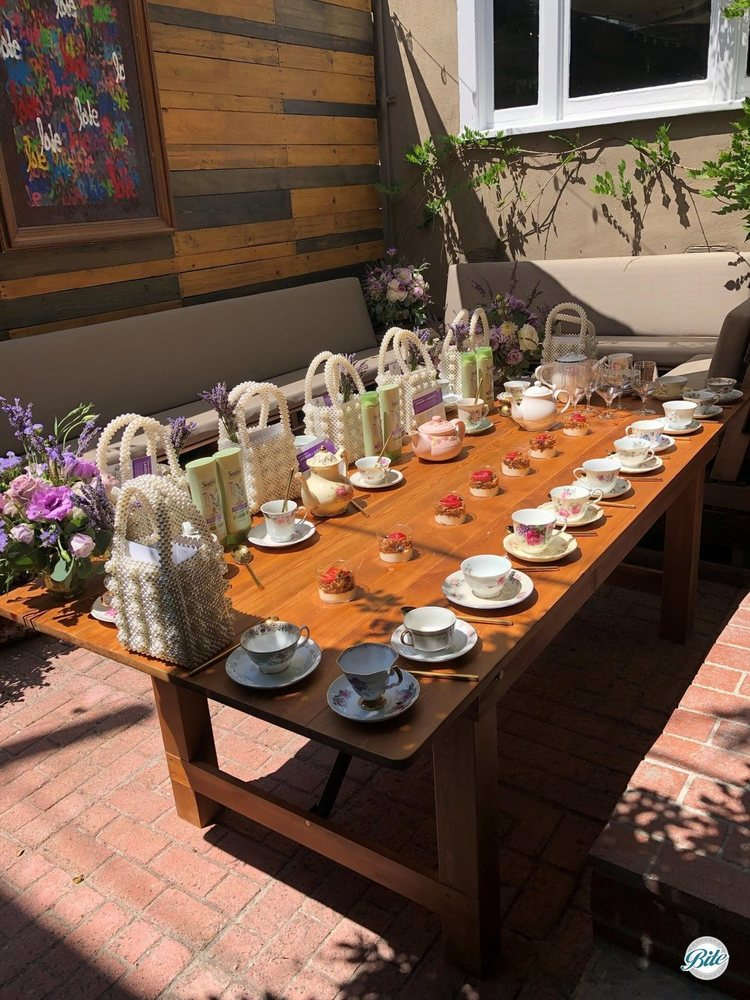 Table setup with parfaits and tea cups with tea pot