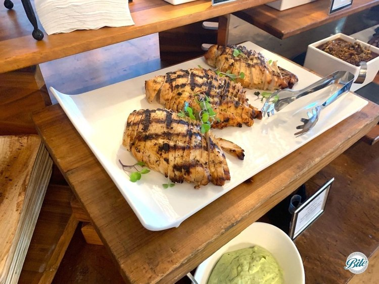 Chicken marinated with tequila lime marinade. Grilled and sliced. Served with avocado crema and cilantro