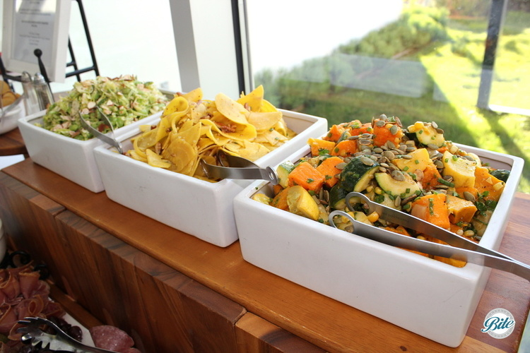 Vegetables served on the display including: roast butternut and japanese pumpkin succoutash, edamame, baby kale, and shaved brussel sprout salad, and shaved gold beets with toasted pecans