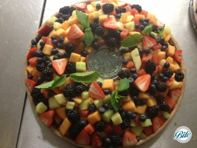 Seasonal fruit salad with honey- mint dressing on to - go platter