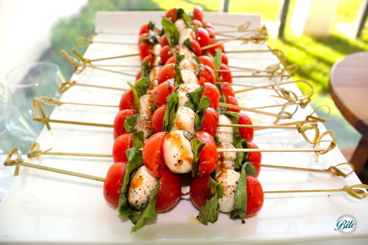 Caprese salad skewers stacked. Mozzarella, cherry tomatoes, basil, balsamic.