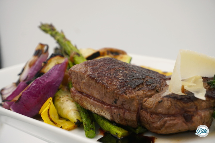 Tuscan steak with fresh herbs, roasted garlic, lemon, parmesan, and a Barolo demi-glace. Served with grilled roasted vegetables