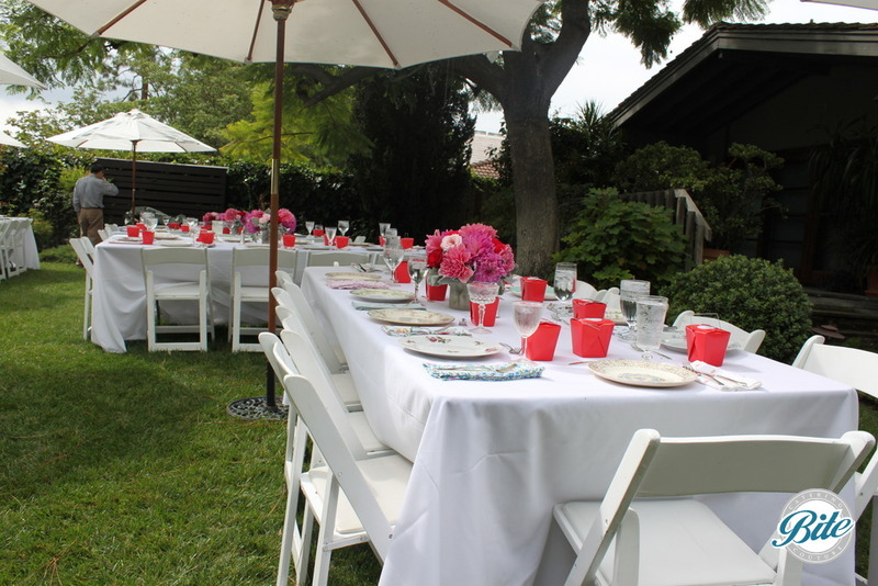 Pink and vintage tablescape at outdoor event