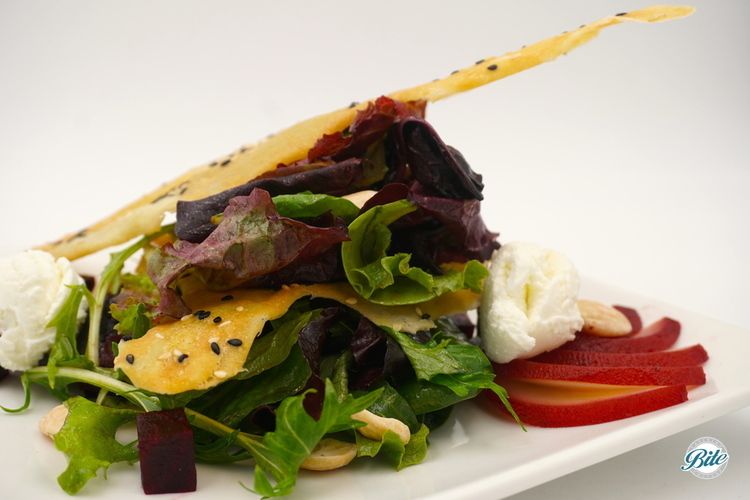 Winter Salad with field greens, beets, pears, goat cheese, marcona almonds, and a sesame touille. Dressed with balsamic
