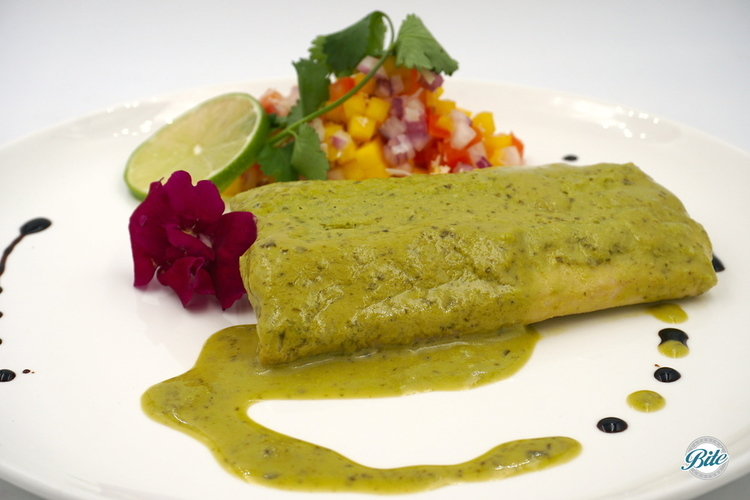 Mahi Mahi pan seared and braised in a coconut salsa verde. Served with a mango coconut salad.