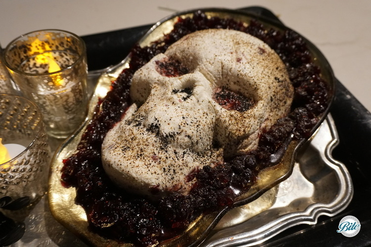 Cranberry-orange blood oozing from a goat cheese based skull.