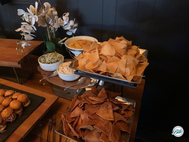 Variety of dips with matching chips. Artichoke spinach dip with pita chips. Pan-fried onion dip with homemade potato chips. Farmers market corn dip with tortilla chips