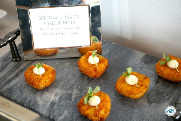 Tray passed mac n cheese croquette with truffle aioli and micro greens