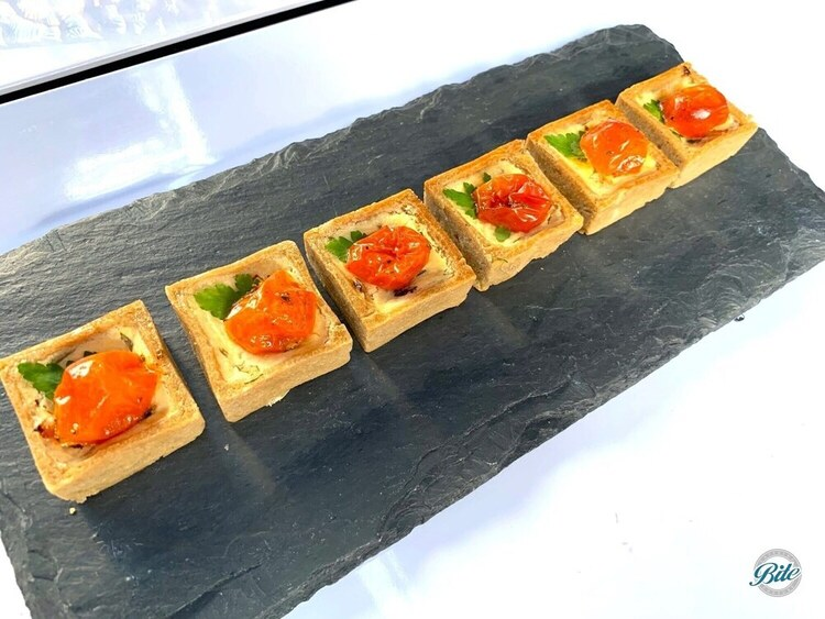 Tomato herb tarts on slate tray