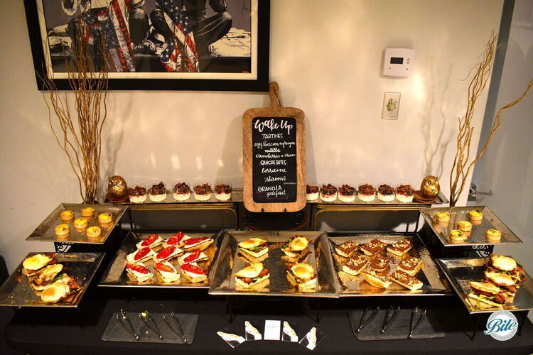 Breakfast display laid out. Tartine options: egg, bacon, gruyere; nutella; strawberries and cream. Quiche options: lorraine; mushroom.