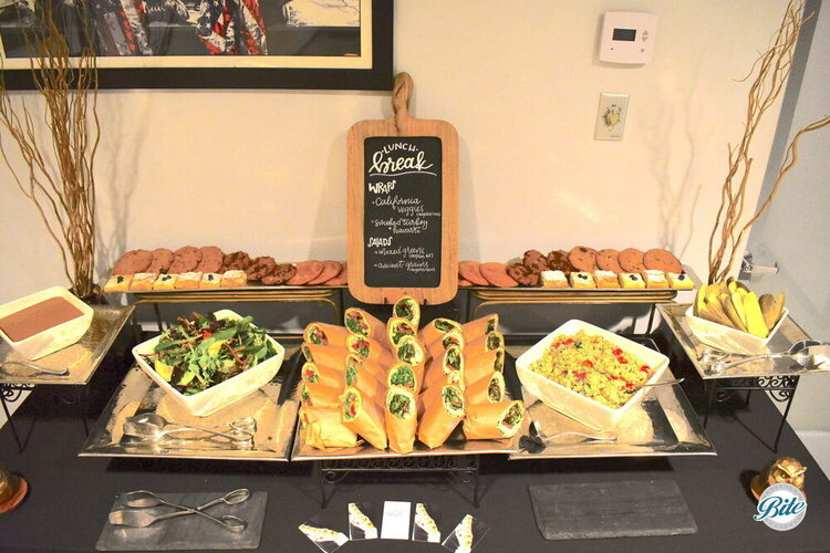 California Veggie and Smoked Turkey wraps served with salad and dessert. Mixed green and ancient grains salad options. Cookie and lemon bars for dessert.