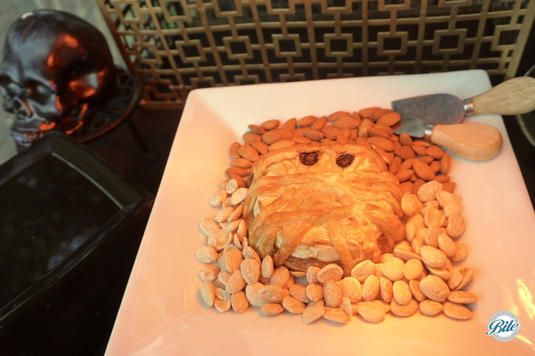 The mummy - brie with puff pastry perfect for a Halloween event! Resting in a bed of regular and marcona almonds.