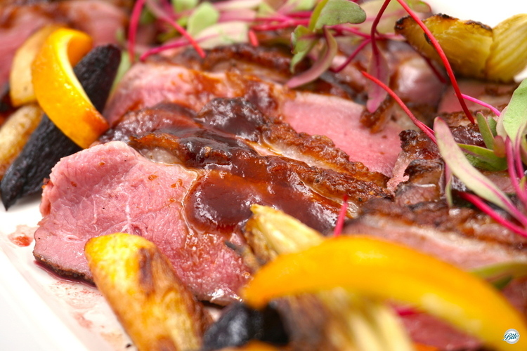 Seared duck breast with a honey lemon glaze and ginger lemongrass jus