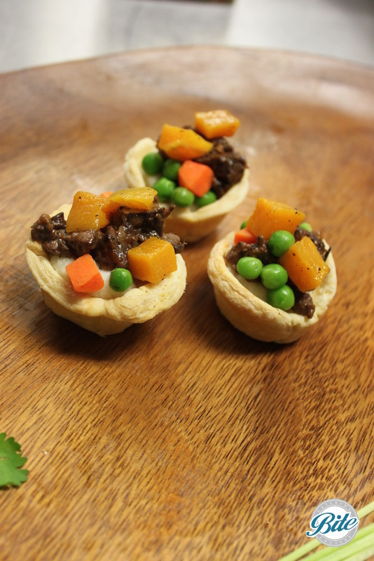 Red wine beef, potatoes, baby peas, carrots and puff pastry tray passed