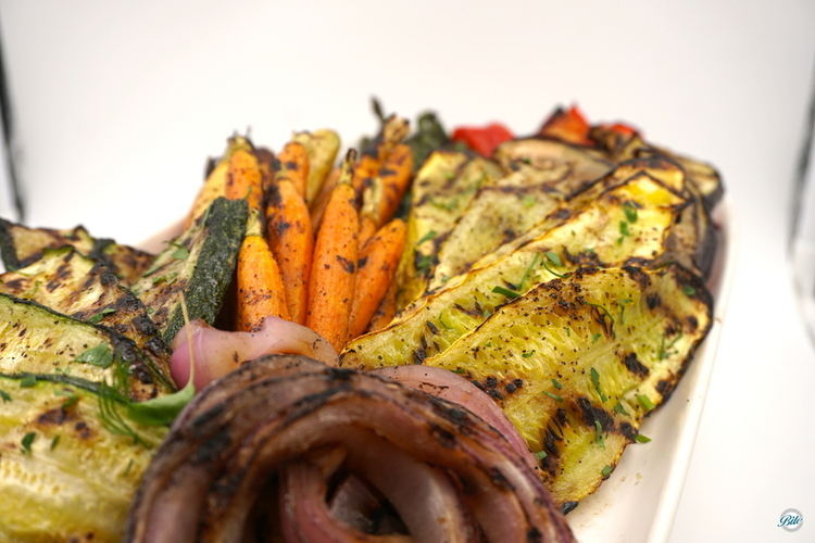 Grilled vegetables on a platter. Onions, squash, carrots, peppers