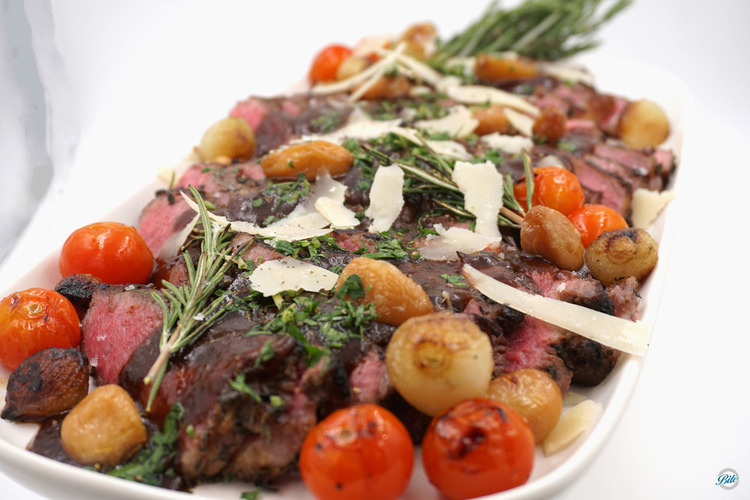 Tuscan NY steak with fresh herbs, roasted garlic, lemon, parmesan, and Barolo demi glace. Served with tomatoes and roasted vegetables