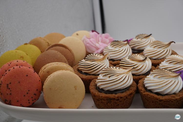 Assorted dessert bites including macaron, s'mores bite, mascarpone cheesecake bite with seasonal berries