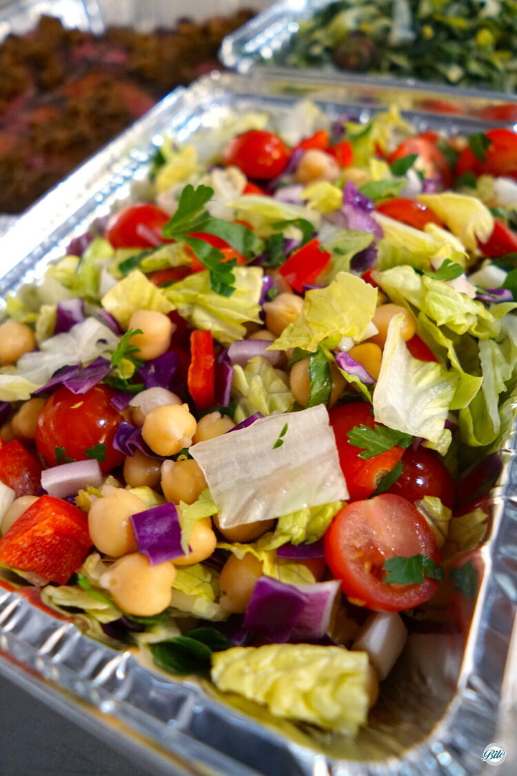 Chopped salad in aluminum. With chickpeas, olives. Italian dressing
