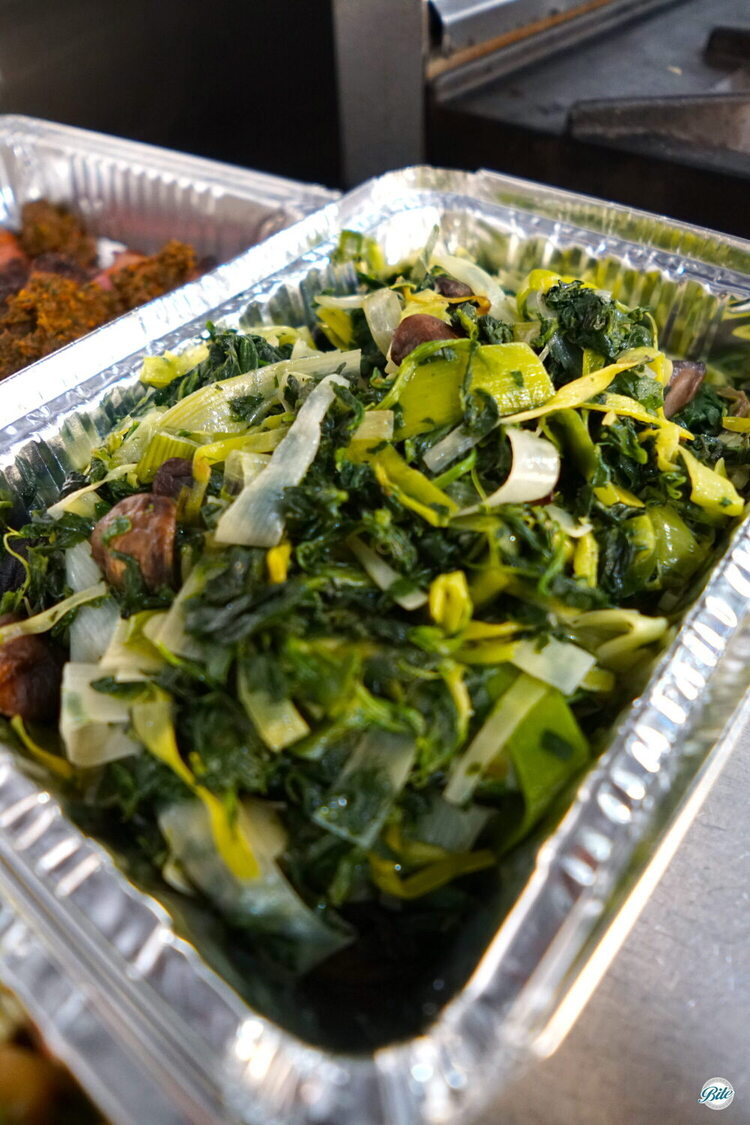 Wilted Greens with spinach, mushrooms, and assorted greens.