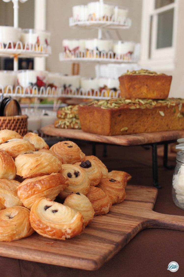 Chocolate crossiants, yogurt triffles and pumpkin bread on display for brunch event