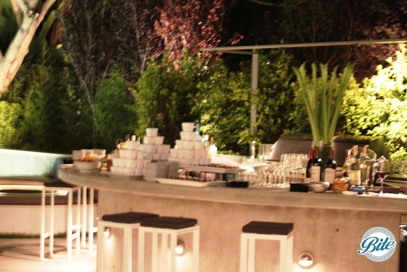 Contemporary bar set up outdoors with concrete and modern design