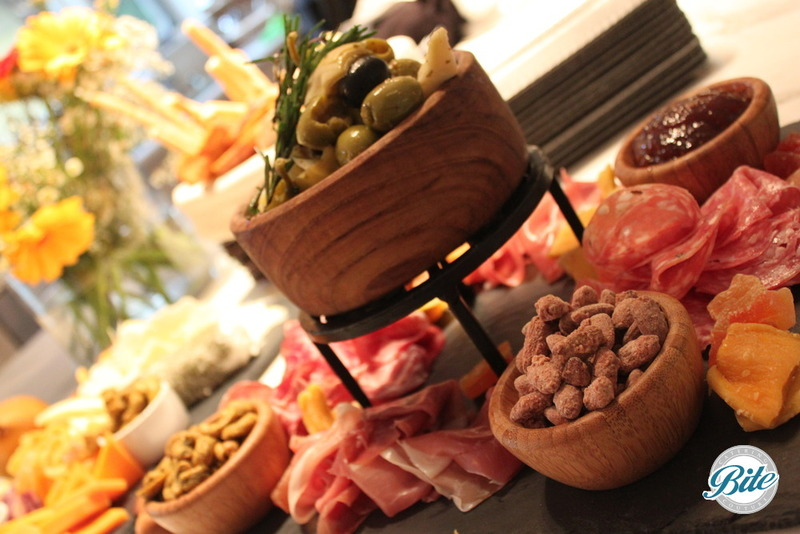 Charcuterie display with Sopressata, Prosciutto, Italian Salami, Pâté, Pickled Accompaniments, Mixed Olives And Olive Oil Crostini
