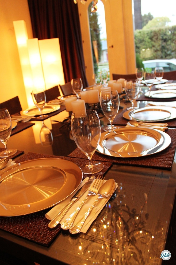 Elegant table setting with soft lighting, ready for plated dinner service