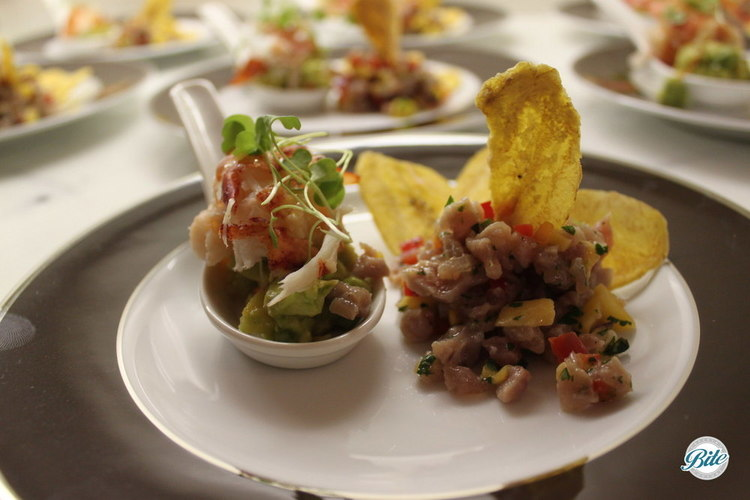 Lobster  tasting  spoon  and  island  ceviche  with  plantain  chips