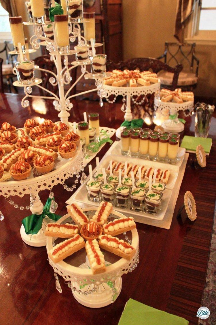 St Patricks day dessert display with Irish coffee pot de creme, chocolate Guinness cake shot, Irish shortbread with caramel and Irish whiskey cream, and caramelized apple tart bites.