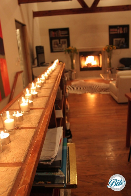 Ambiance with tea lights, and fireplace at a private event.