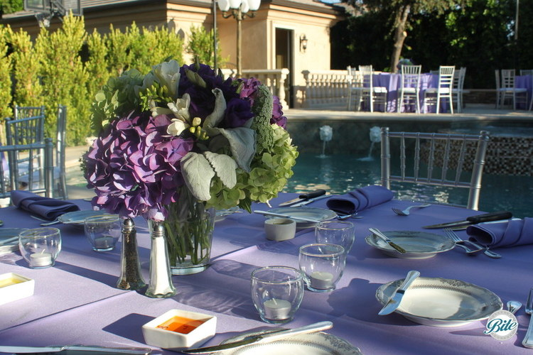 Backyard dining with lavender and green colors